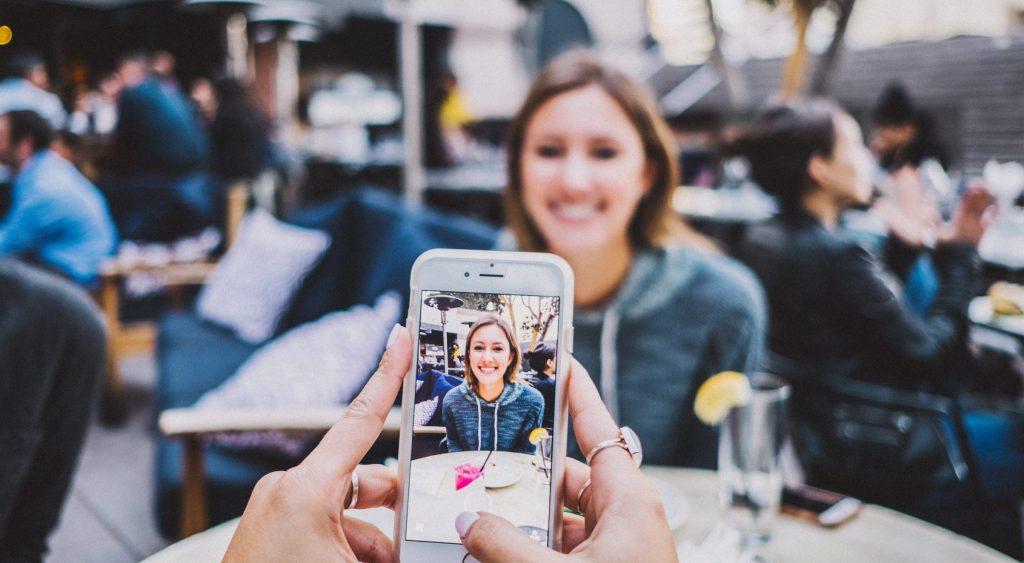 woman taking a photo of a friend.jpg