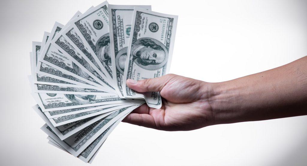 Image of holding money